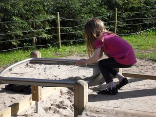 Playing with sand at Drayton Manor